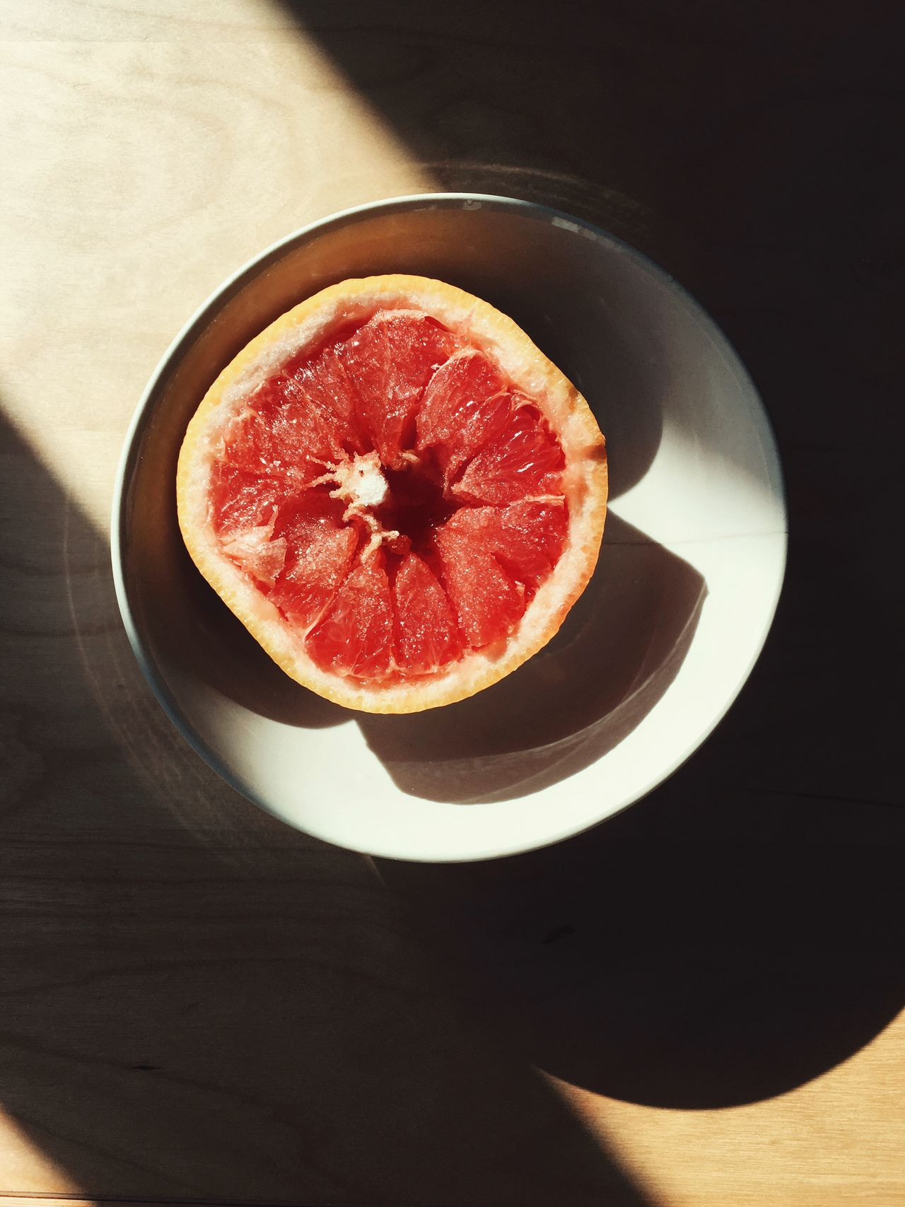 Grapefruit Fruit Breakfast Light And Shadow Table Wooden Table High Angle View View From Above Fresh Healthy Eating Lifestyle Freshness Directly Above Food SLICE Indoors  Ready-to-eat Halved Plate