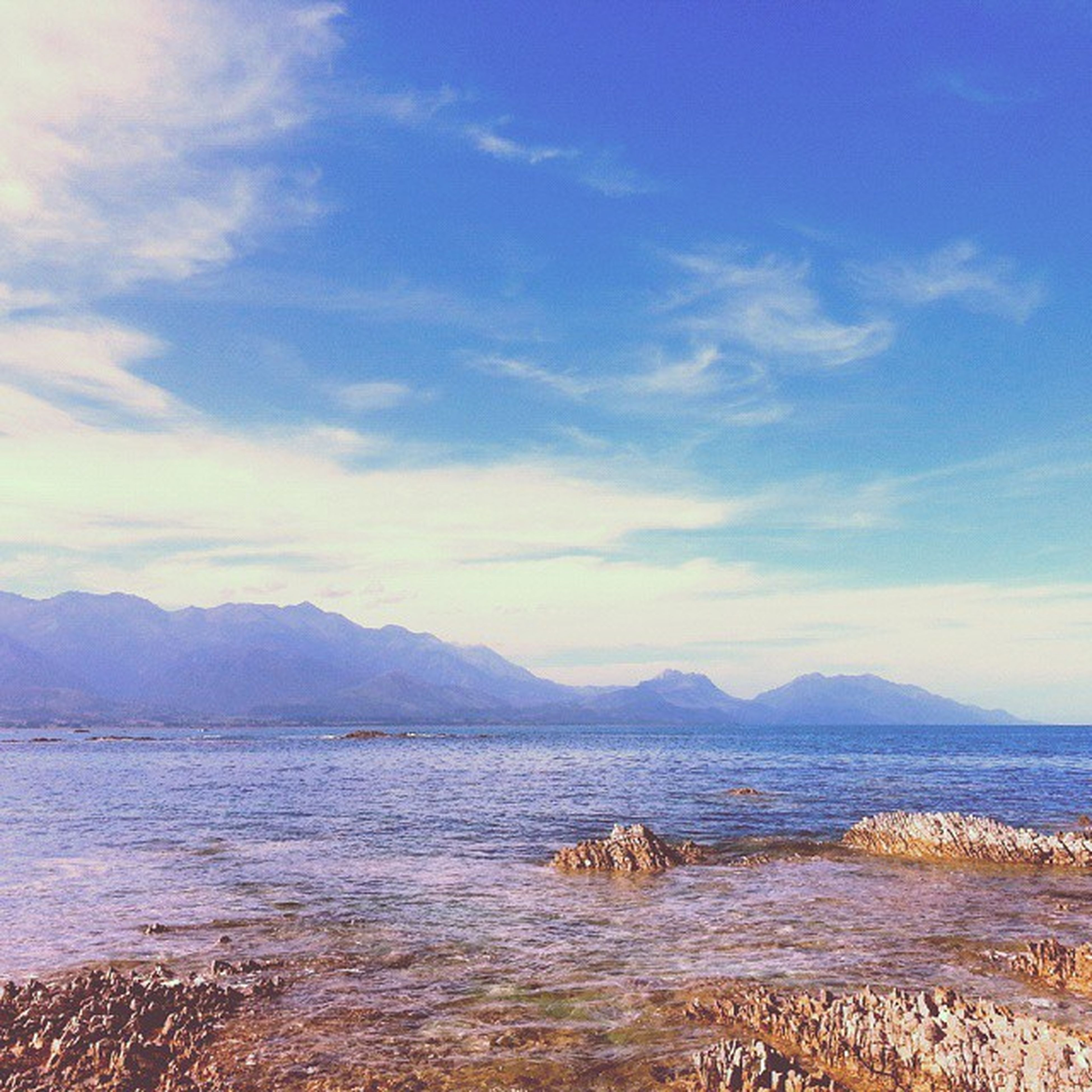 mountain, water, scenics, sea, sky, tranquil scene, tranquility, beauty in nature, mountain range, beach, cloud - sky, nature, shore, idyllic, cloud, coastline, sand, outdoors, non-urban scene, remote