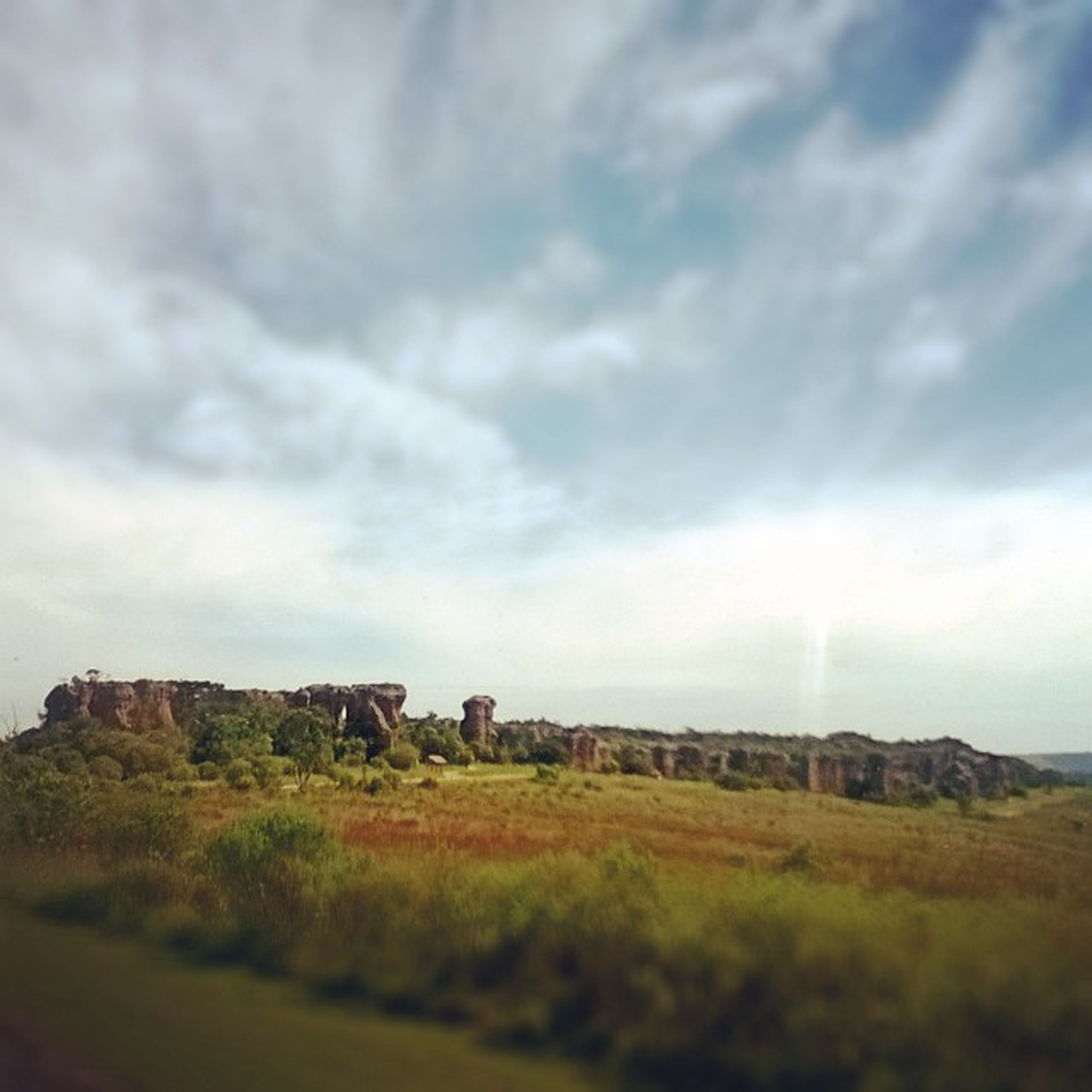 sky, cloud - sky, architecture, built structure, building exterior, landscape, cloudy, field, cloud, grass, rural scene, nature, old ruin, history, day, agriculture, tranquility, old, tranquil scene, abandoned