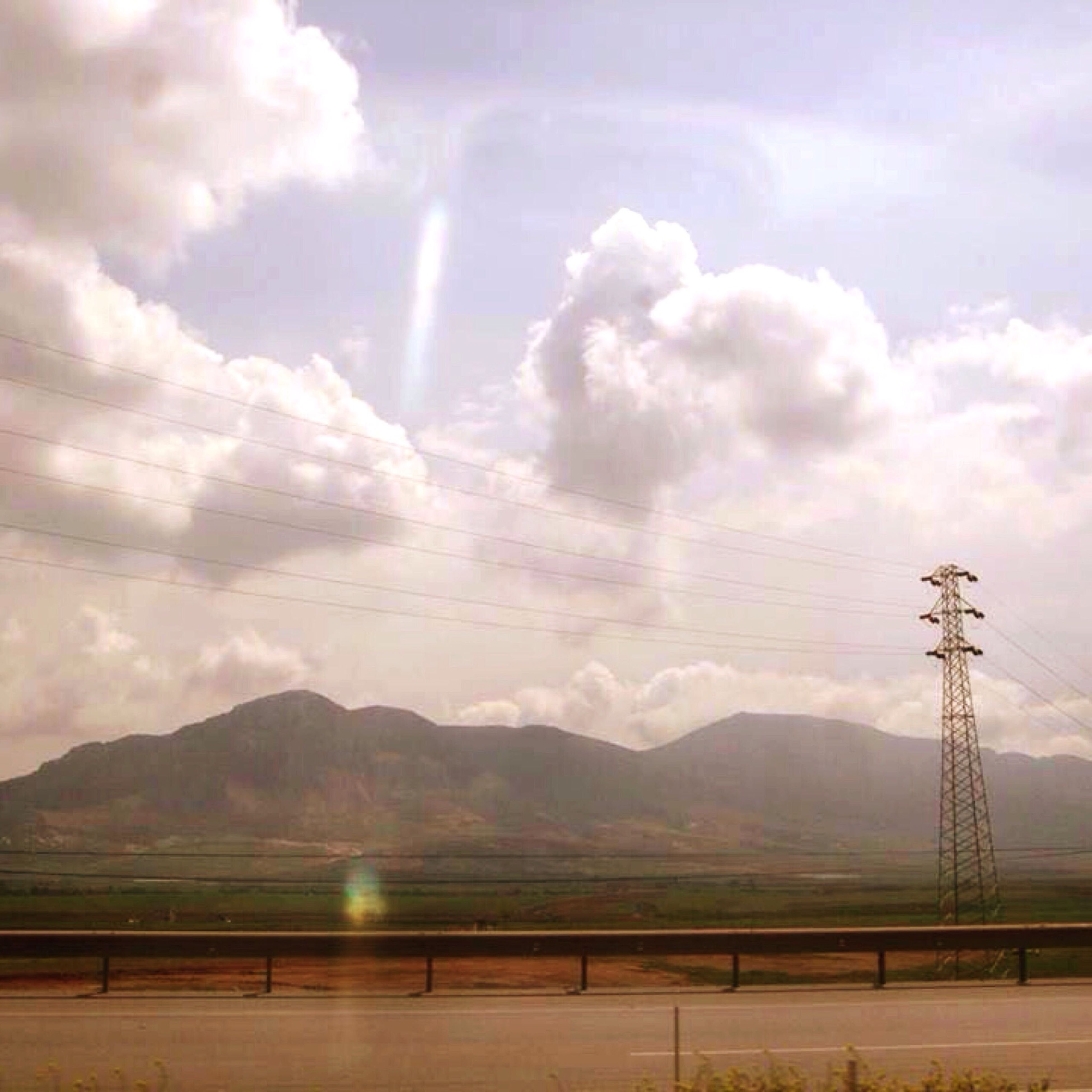 mountain, sky, mountain range, tranquil scene, tranquility, scenics, landscape, cloud - sky, beauty in nature, cloudy, nature, electricity pylon, cloud, non-urban scene, electricity, weather, idyllic, fence, connection, fuel and power generation