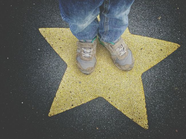 Boys Feet Standing on Yellow Star Playground Paint The Town Yellow