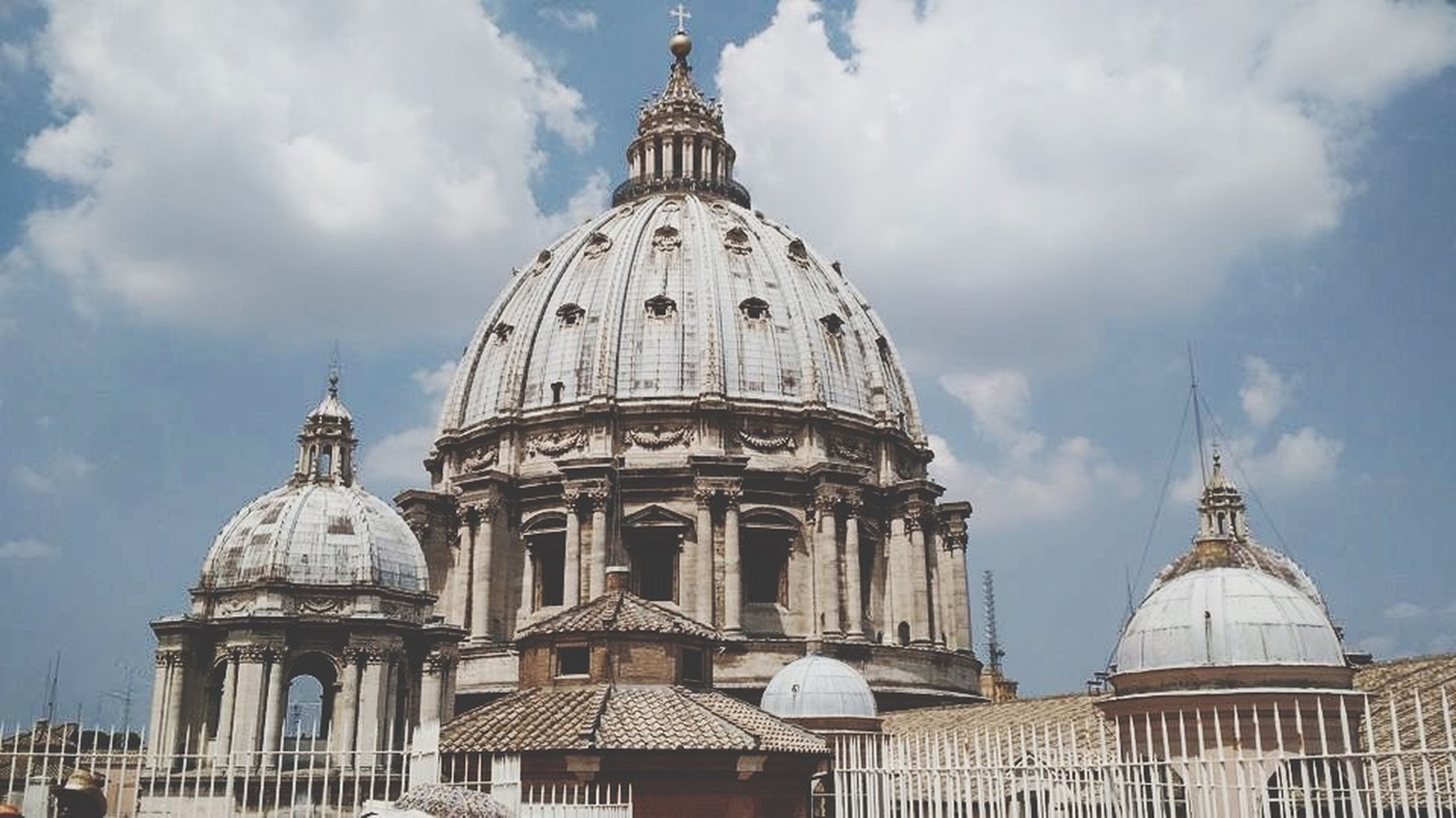 architecture, built structure, dome, building exterior, place of worship, sky, religion, famous place, spirituality, travel destinations, low angle view, tourism, cloud - sky, travel, international landmark, cathedral, church, capital cities, cloud