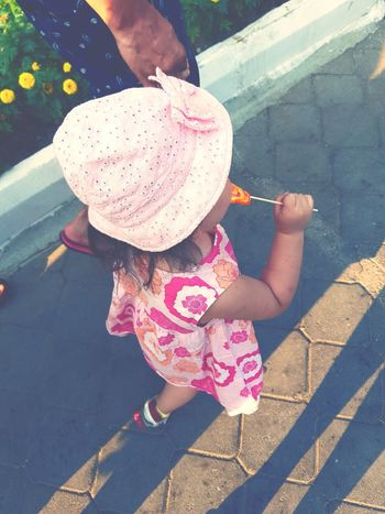 Pink Color Girls Child One Person One Girl Only Outdoors High Angle View Summer People Sun Hat Day Childhood Lifestyles Human Body Part Beauty