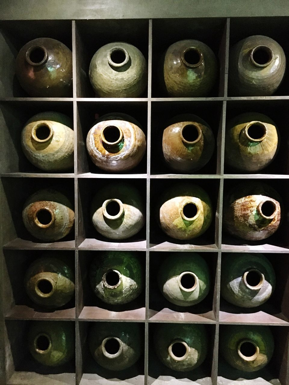 bottle, in a row, shelf, indoors, no people, wine, large group of objects, multi colored, alcohol, close-up, multiple image, day