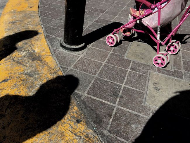 High Angle View Outdoors Shadow Day Low Section One Person Nature Streetphotography Children Kids Child Transportation Pram Stroller Child Carrier Kinderwagen The Street Photographer - 2017 EyeEm Awards