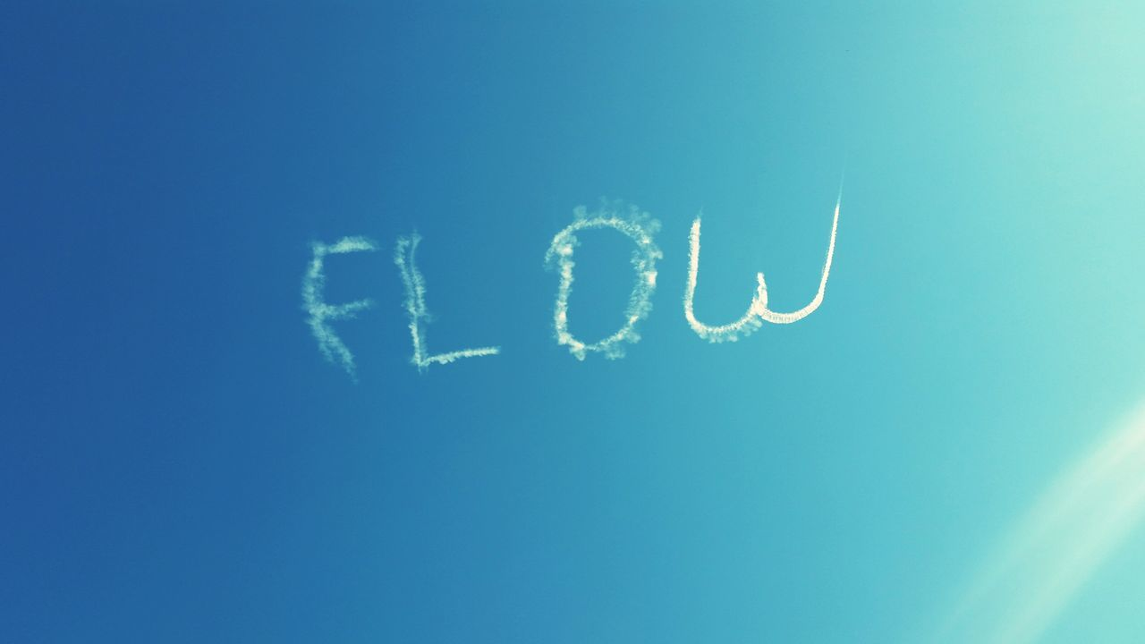 FLOW by skywriter Sky Writing Sky Flow  Jazzfest Summer New Orleans NOLA Louisiana