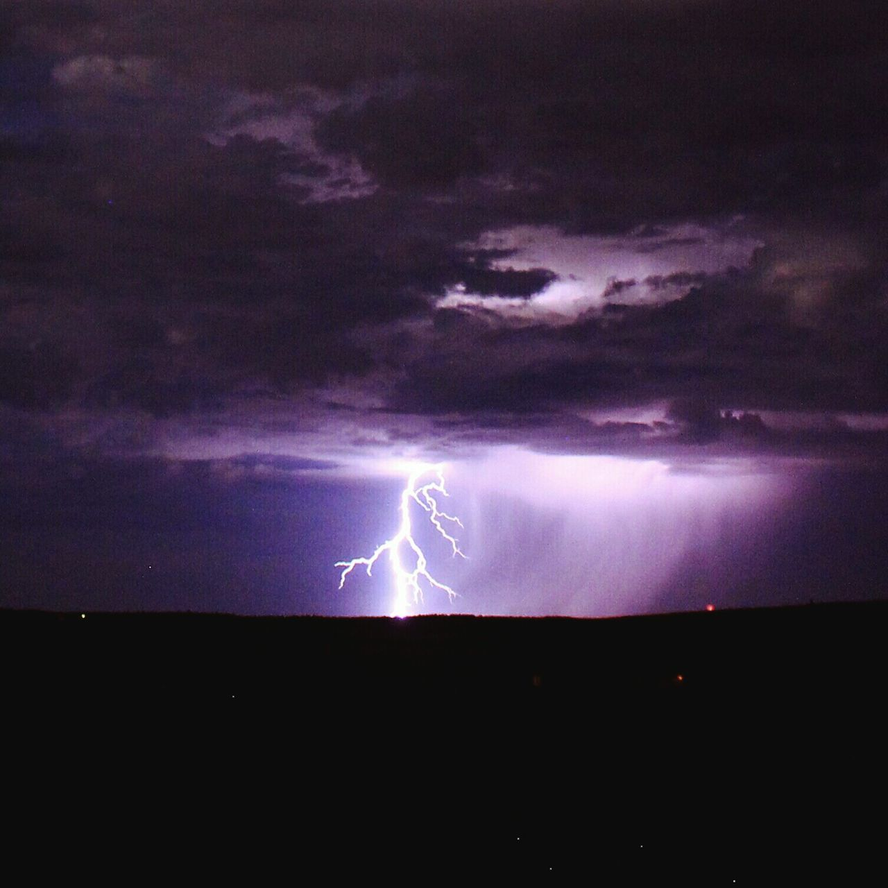 lightning, thunderstorm, forked lightning, power in nature, storm cloud, sky, cloud - sky, storm, dramatic sky, weather, atmospheric mood, nature, scenics, night, danger, beauty in nature, dark, landscape, no people, silhouette, outdoors, illuminated, moon, horizon over water