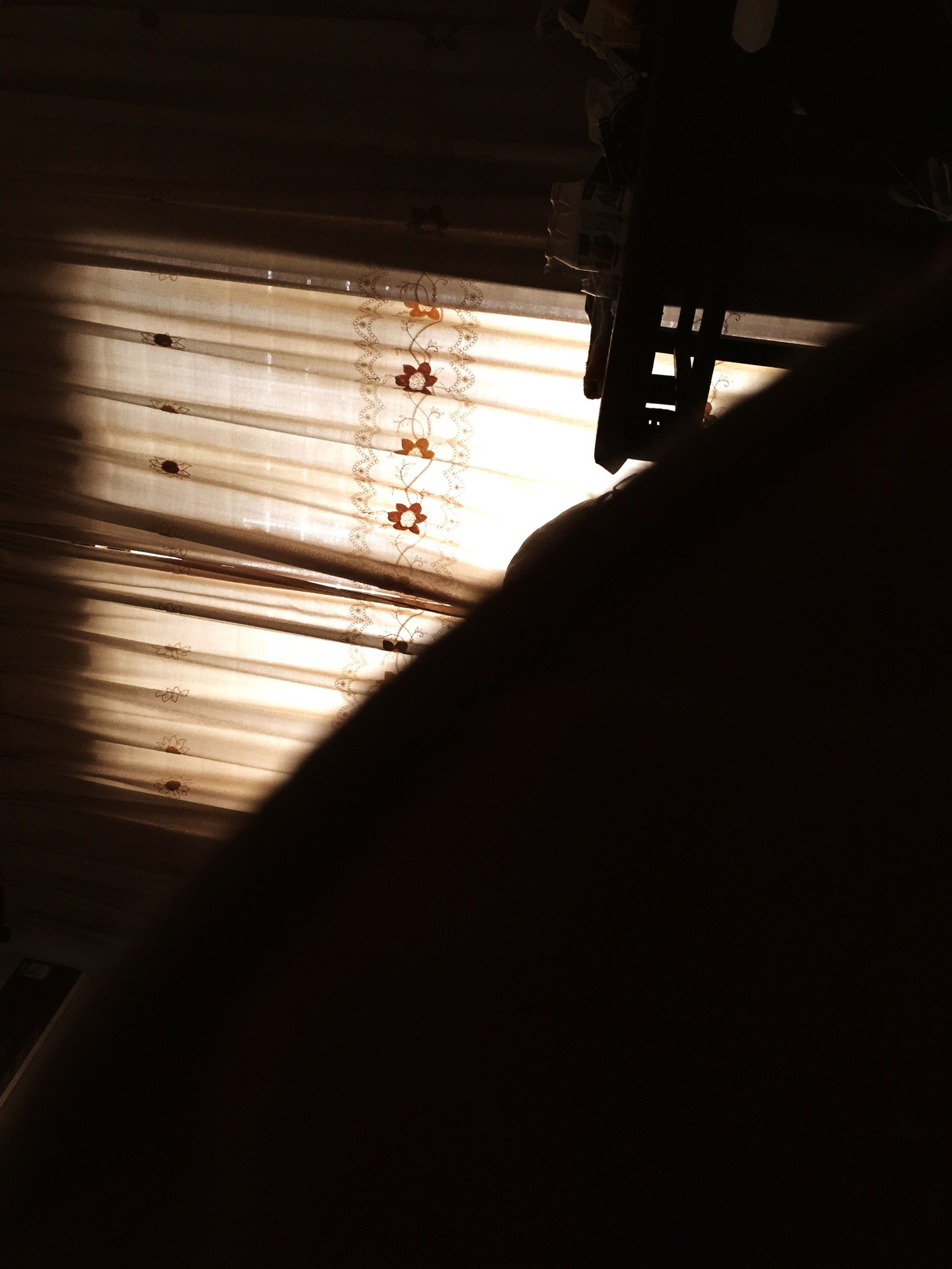indoors, lifestyles, silhouette, dark, unrecognizable person, leisure activity, shadow, sunlight, men, standing, window, transportation, person, part of, high angle view, day