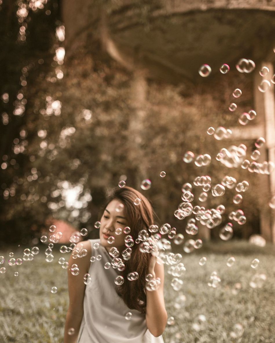 Sunlit evenings with Amanda Happiness Enjoyment One Woman Only Outdoors Waist Up Light Light And Shadow Long Goodbye Portrait Of A Woman Dreamlike Women Around The World Sunlight Summer Individuality Beautiful People EyeEm Diversity Bubbles Bubble Beauty In Nature Bokeh Bokeh Photography TCPM