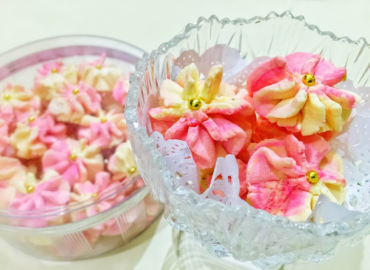 food and drink, freshness, still life, indulgence, bowl, drinking glass, flower, serving size, no people, pink color, close-up, food, indoors, high angle view, ready-to-eat, sweet food, temptation, slice, plate, dessert, fruit, drink, flower head, day