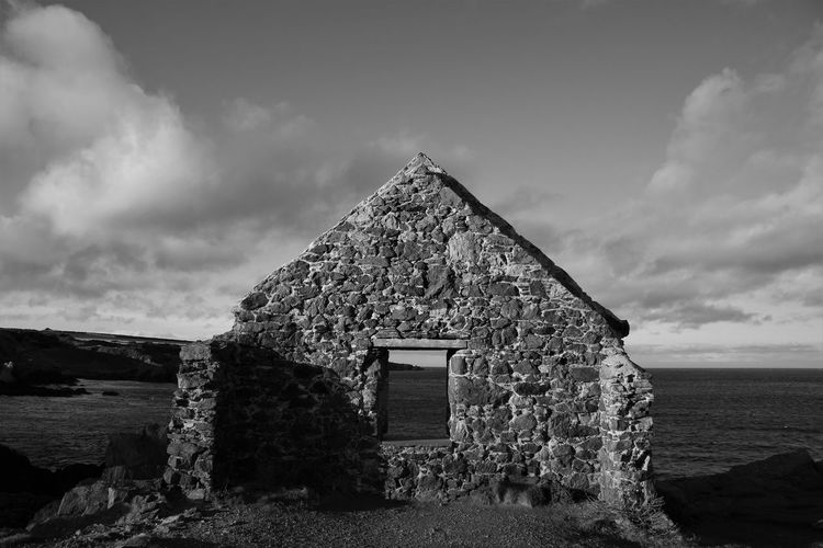 Abandoned Buildings Architecture Beauty In Nature Blackandwhite Building Exterior Built Structure Cloud - Sky Day Landscape Monochrome Moray Nature No People Outdoors Portsoy Portsoy Harbour Ruins Scenics Sea Sky Tranquil Scene Tranquility Tree Window