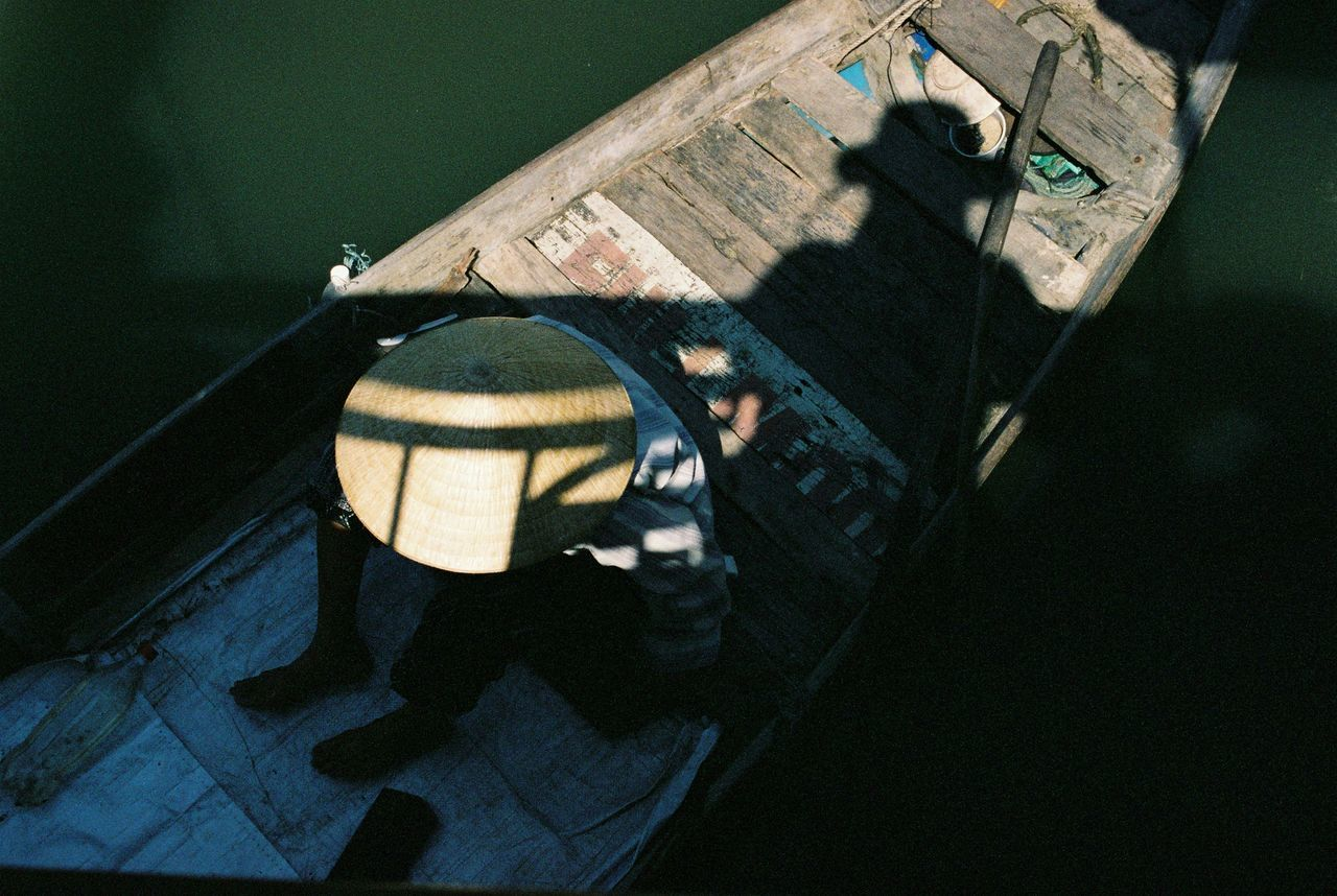 High Angle View Of Man In Boats Sailing On River