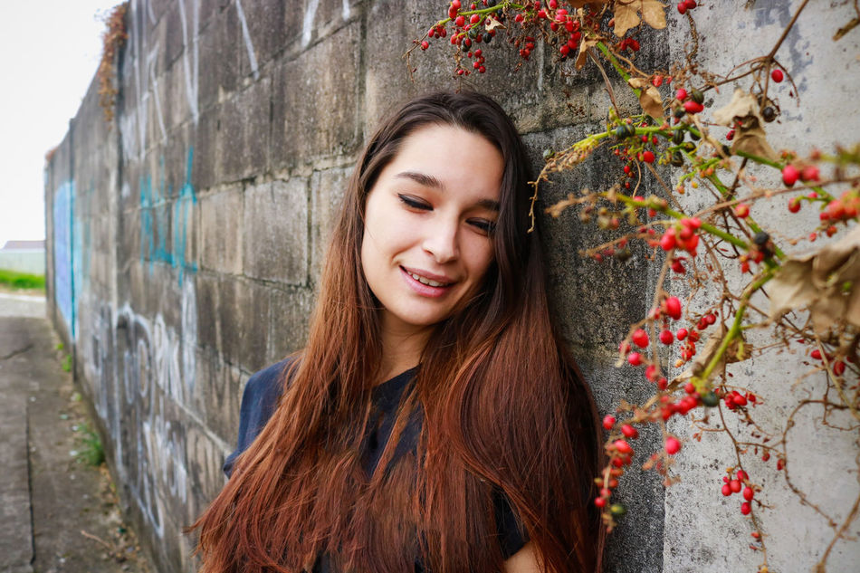 Adult Adults Only Casual Clothing Cheerful Close-up Day Happiness Leisure Activity Long Hair Looking At Camera Nature One Person One Woman Only One Young Woman Only Outdoors People Portrait Real People Smiling Standing Toothy Smile Tree Young Adult