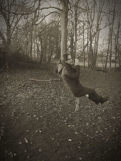 Amy playing on a rope swing. Ropeswing  Woodlandwalks Sepiastyle FunTimes!