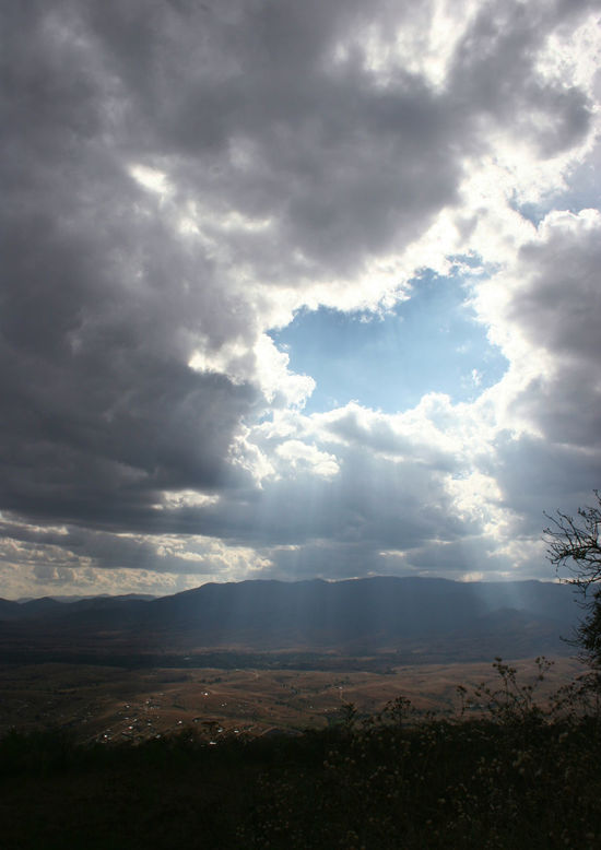 The sun piercing through the clouds. Light Beauty In Nature Breaking Through  Cloud - Sky Day Idyllic Landscape Mountain Mystical Nature No People Outdoors Scenics Sky Sunlight Tranquil Scene Tranquility