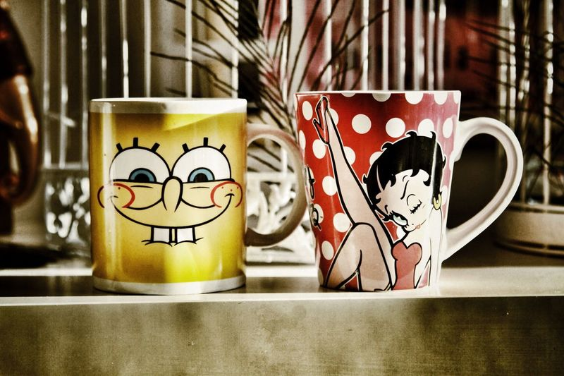 His & Hers ColorPalette Betty Boop Business Choice Close-up Coffee Two Is Better Than One Cup Drink Focus On Foreground Food And Drink His And Hers Hot Chocolate Indoors  Love Mug No People Order Refreshment Single Object Spongebob Still Life Table Tea Variation