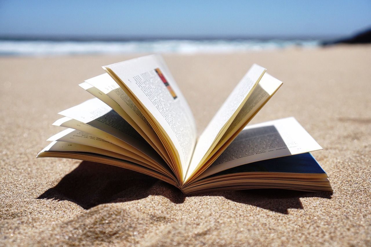 Book Page Reading Literature Close-up Textbook Education Intelligence Beach Sand Paper No People Beachphotography Holiday Booklover Vacations Beach Life Enjoying Life Enjoying The Sun Outdoors Lifestyles Sea Summer Sand & Sea