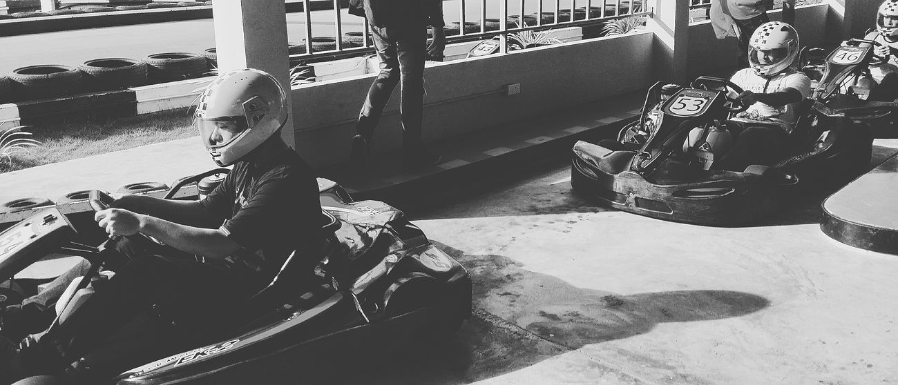 Son Go-karting Chaweng Koh Samui Thailand Travelphotography Streetphotography People Watching Capture The Moment Snapshots Of Life Bnw_life Bnw_captures Bnw_travel Bnw_world Bnw_kohsamui Bnw_thailand Bnwcollection Bnwphotography Streetphotography Eyeem Streetphotography