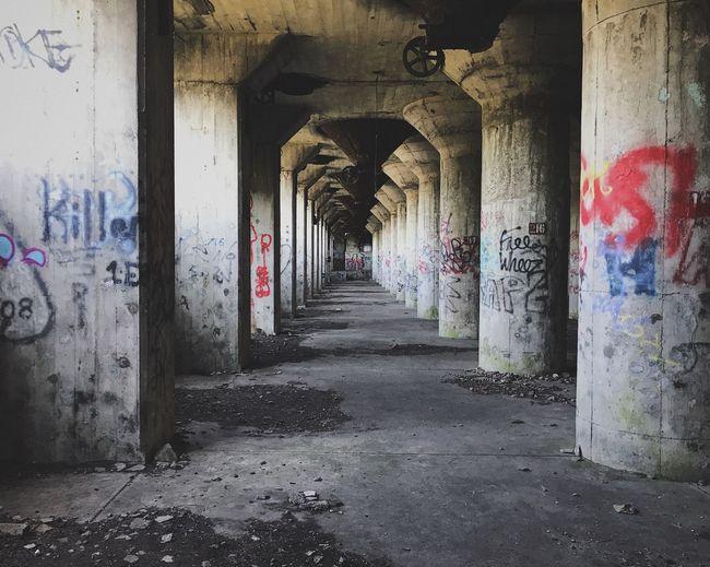 Architectural Column Indoors  Built Structure Architecture Corridor No People Abandoned Buildings Graffiti Art Concrete Empty Warehouse Explore Urban Landscape Urban Exploration