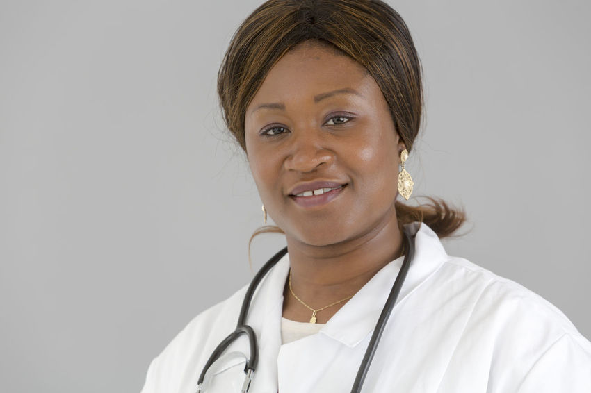 Medical Beautiful Woman African Girl  African Portrait Stethoscope  Pediatrician Hospital Pediatrics Nurse Doctor  Clinic White Background Looking At Camera Looking To The Camera Reassurance Front View Selfconfident Self Confidence Posing Reassuring Self Confident Smiling Reassure The Portraitist - 2017 EyeEm Awards
