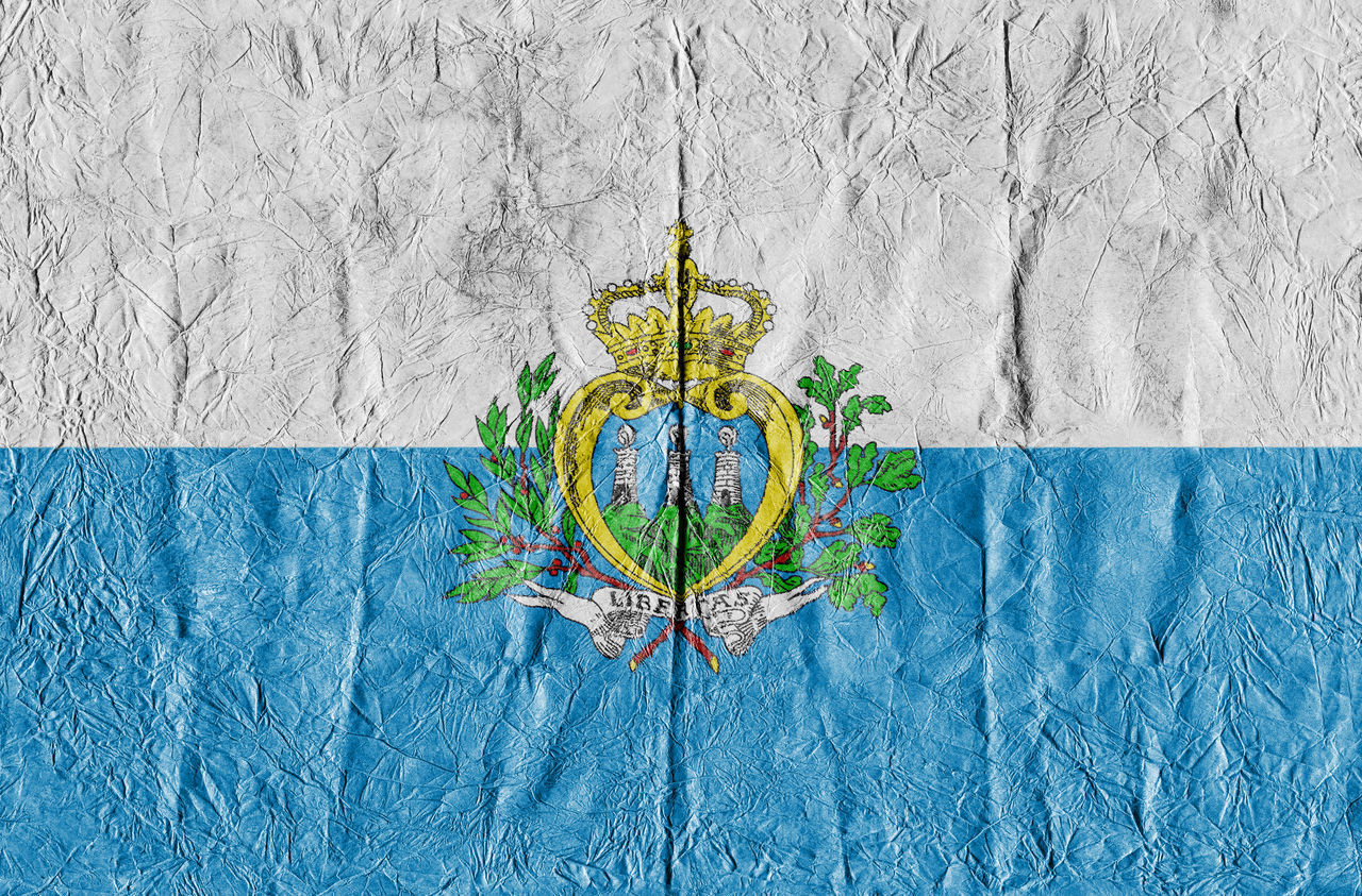 San Marino flag on a paper in close-up Freedom Growth Isolated Land San Marino San Marino Flag Textured  Travel Background Close-up Concept Country Flag Eu Europe Flag National Flag National Land Paper Pattern State Symbol