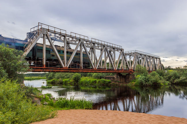 Train. Railway bridge over the river Volchina. The beach next to the railway bridge, Maksatikha station. Train Architecture Bridge - Man Made Structure Built Structure Day Horizontal No People Outdoors Railroad Railway Bridge River Russia Sky Transportation Volchina Water