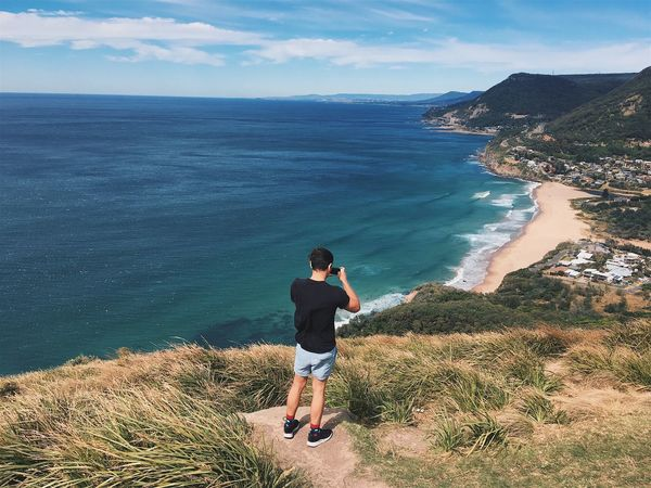 Sea Nature Water One Person Scenics Beauty In Nature Real People Horizon Over Water Leisure Activity Sky Day Standing Outdoors Lifestyles Full Length Tranquil Scene Tranquility Vacations Beach Stanwell Tops Australia Taking Photos Smart Phone Technology Social Media