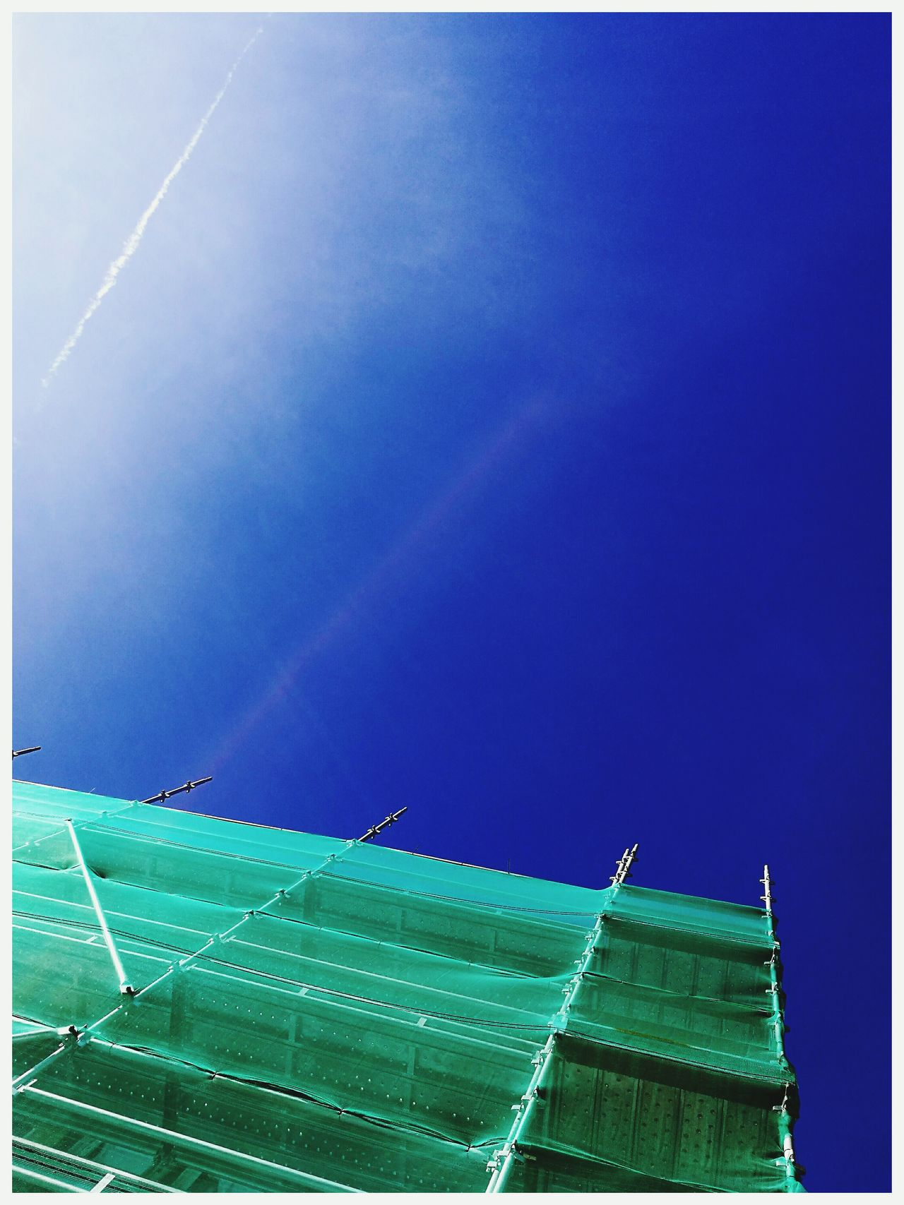 Scaffolding Netting Green plank of wood Metal building restoration blue sky Straight Lines Textured  Building Exterior Built Structure Architecture Outdoors Light Cloud
