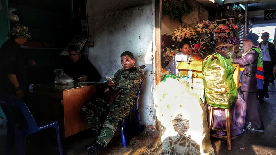 Real People Mature Adult Mature Men Indoors  Participant Illuminated Bangkok Thailand Working Streetphotography Street Photography Streetphoto_color Street Life Thaprajan Thaprachan Soldier Relax Sitting