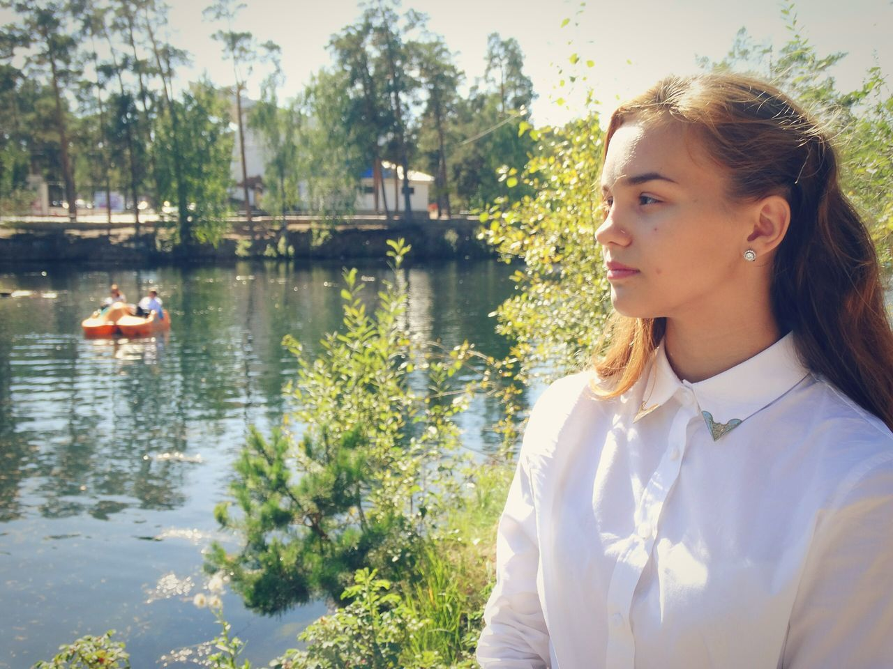 real people, water, tree, leisure activity, lake, young adult, young women, one person, lifestyles, nature, day, outdoors, nautical vessel
