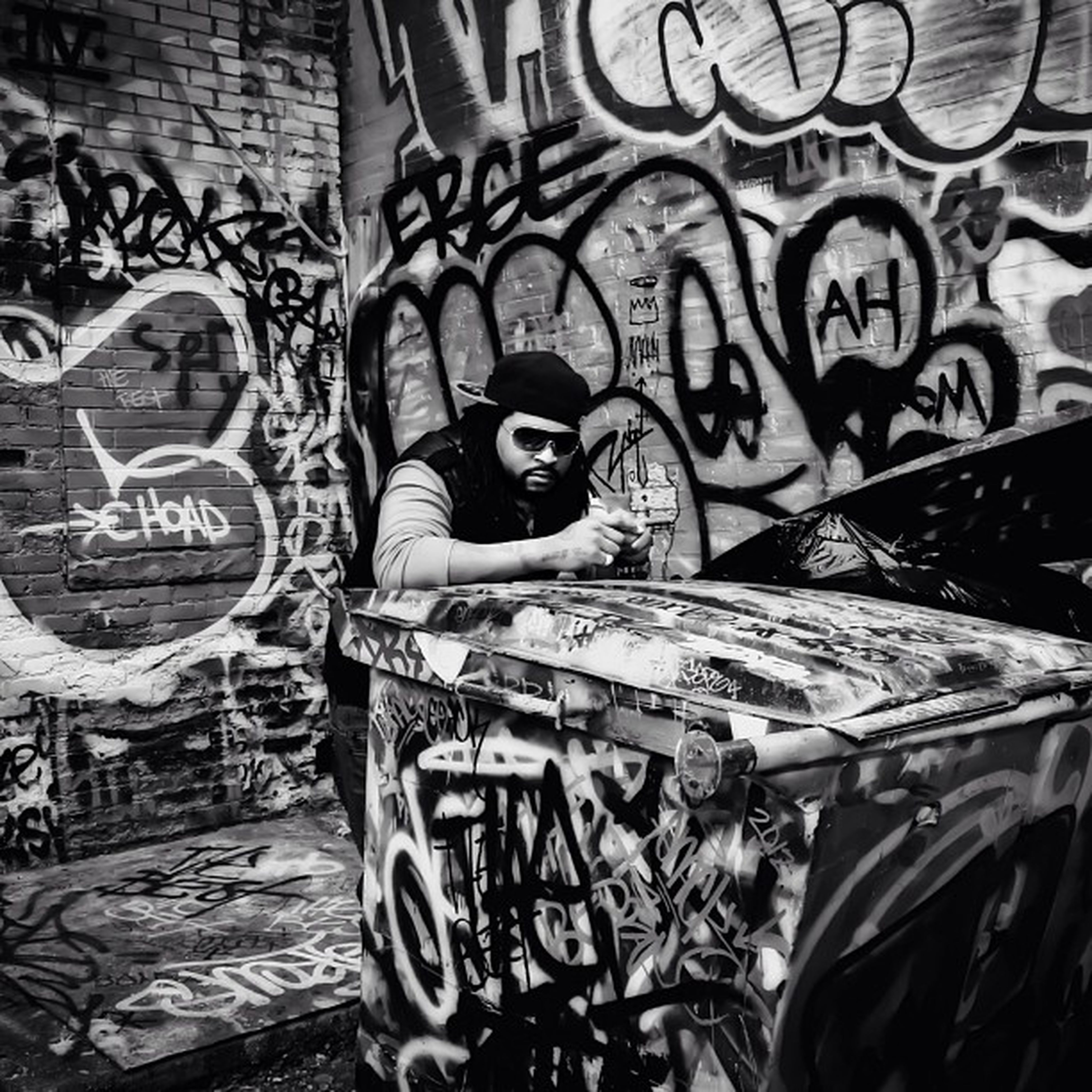 art, art and craft, graffiti, creativity, human representation, built structure, architecture, text, wall - building feature, animal representation, street art, design, building exterior, sculpture, craft, statue, day, mural