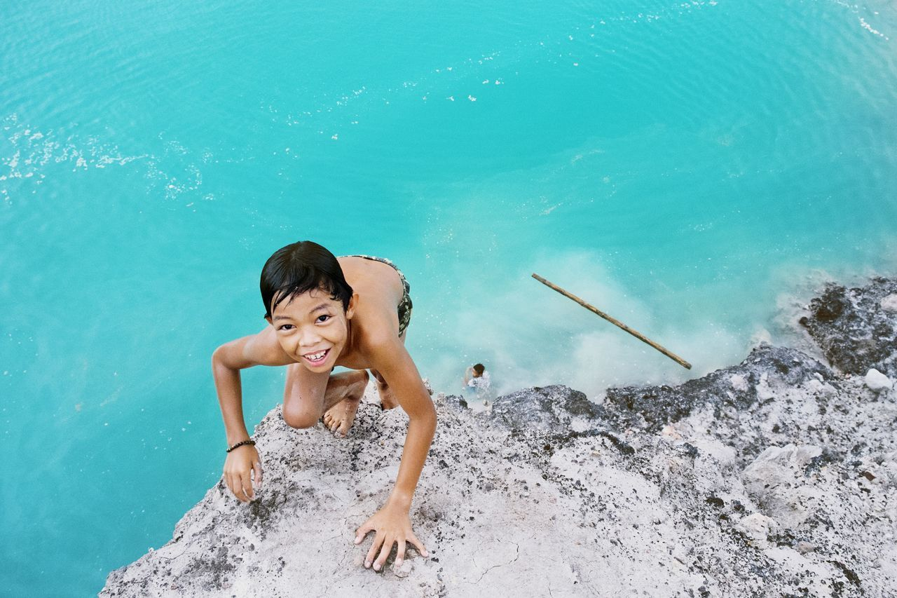 Heaved up over the ledge | Binuang, South Borneo. Natural Light Portrait Blue Wave The KIOMI Collection Youth Of Today Faces In Places The Action Photographer - 2015 EyeEm Awards The Moment - 2015 EyeEm Awards Open Edit INDONESIA EyeEm Best Shots People Enjoying Life RePicture Growth Adrenaline Junkie My Best Photo 2015