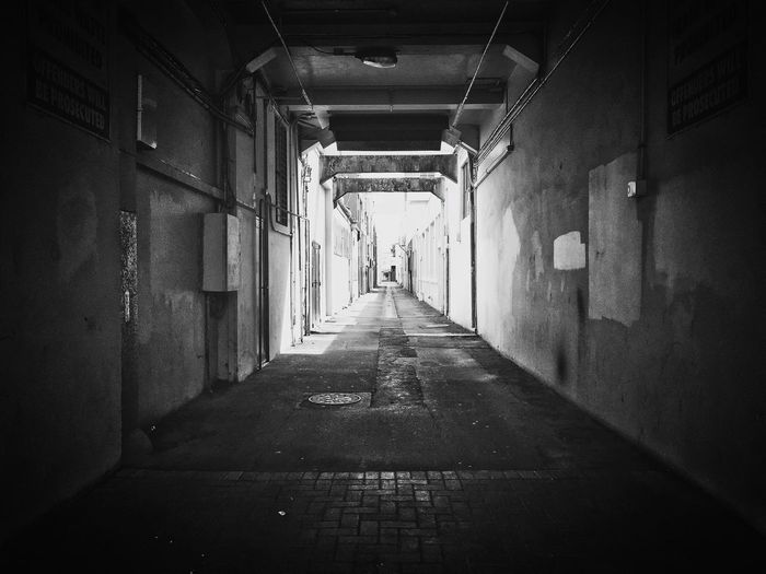 Abandoned aisle in Napier The Way Forward Empty Built Structure Architecture Day Passageway No People First Eyeem Photo Blackandwhite Lines And Shapes Napier FirstEyeEmPic EyeEm EyeEm Best Shots EyeEm Gallery EyeEm Best Edits EyeEmBestPics EyeEmNewHere Connected By Travel