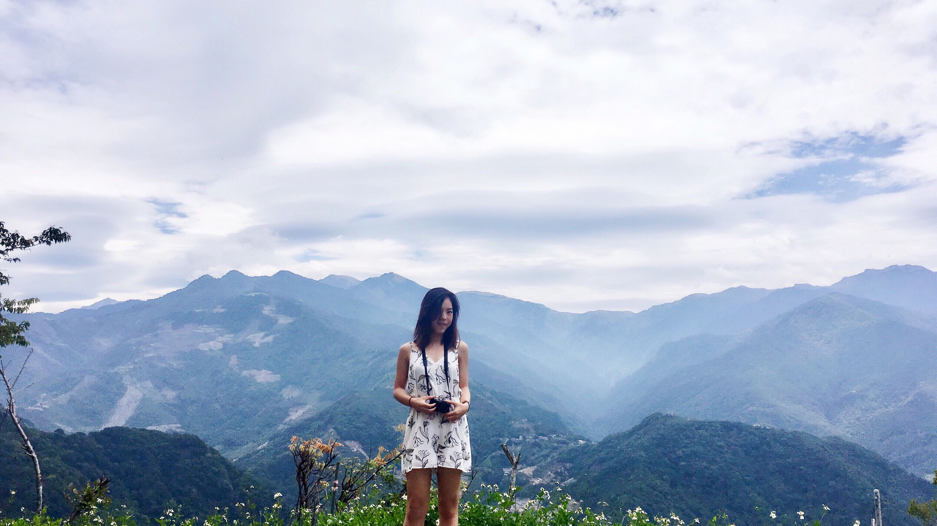 mountain, sky, real people, standing, cloud - sky, young adult, mountain range, beauty in nature, nature, one person, young women, day, casual clothing, outdoors, lifestyles, women, scenics, beautiful woman, tree, adult, people