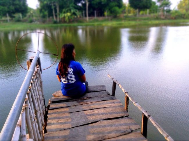 Eyeem Philippines Album The Week On Eyem Eyeem Philippines Enjoying Life Real People Water Railing One Person Rear View Leisure Activity Bridge - Man Made Structure Outdoors Full Length Nature Day Lifestyles Beauty In Nature Young Adult People