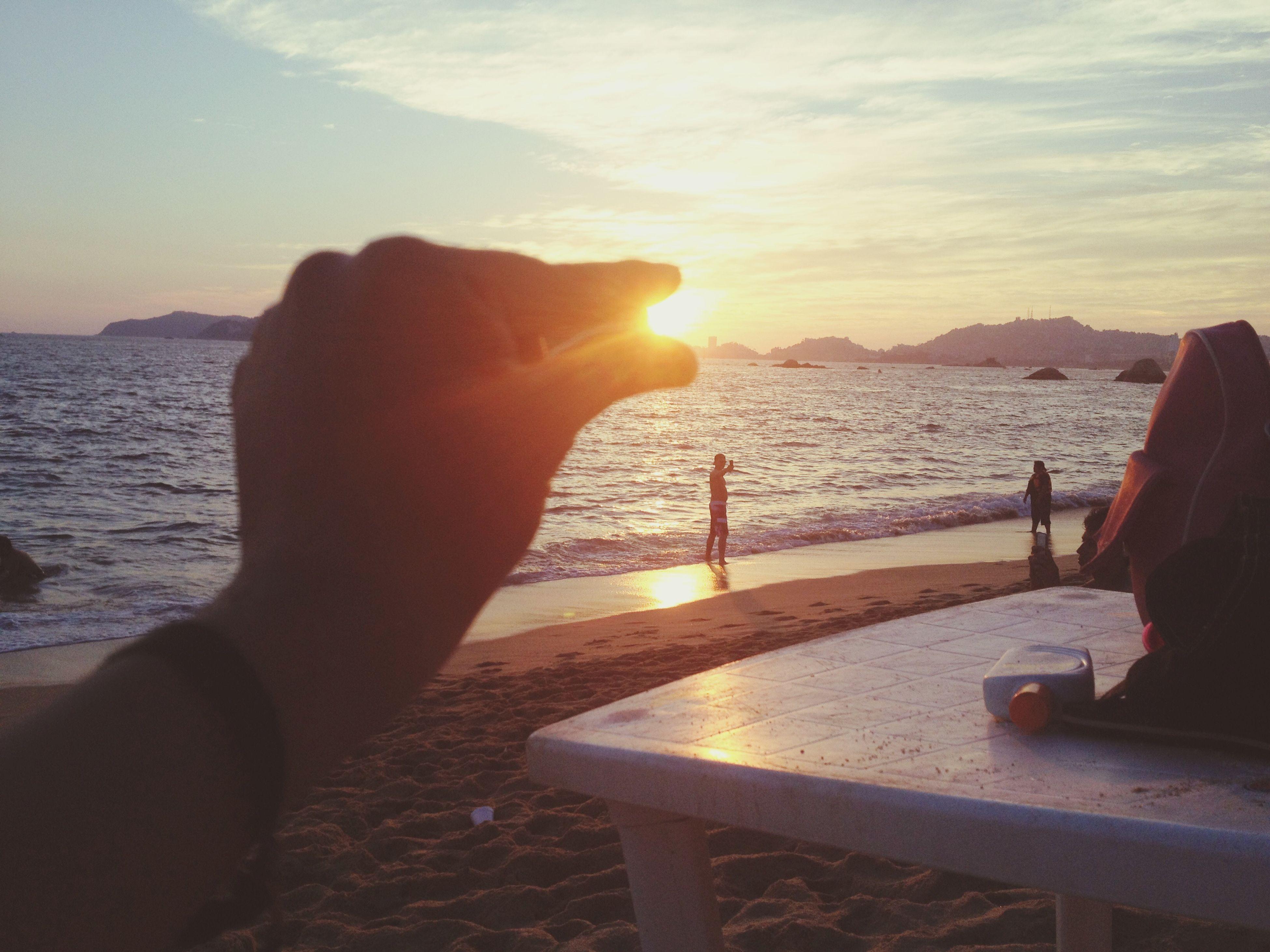 sea, sunset, water, sky, scenics, beach, sun, tranquil scene, beauty in nature, tranquility, horizon over water, silhouette, nature, mountain, orange color, sunlight, idyllic, shore