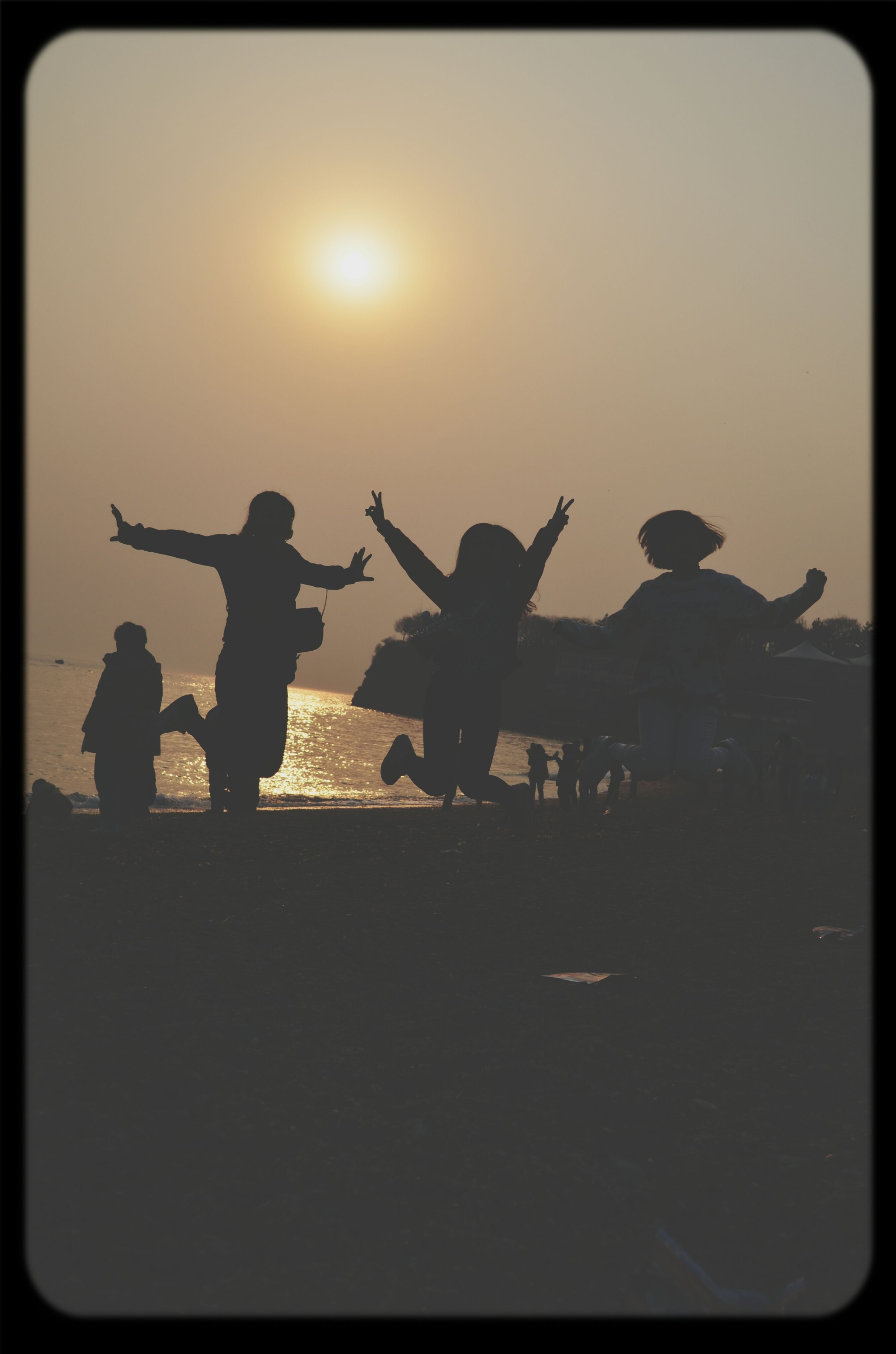 transfer print, lifestyles, leisure activity, silhouette, men, enjoyment, sunset, auto post production filter, fun, togetherness, playing, sun, performance, sky, large group of people, person, mid-air, flying, clear sky
