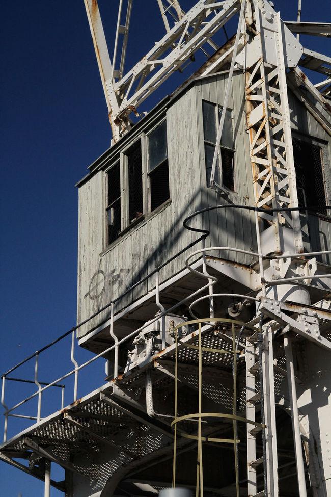 Architectural Feature Architecture Blue Building Built Structure Construction Crane Crane Day Development Fire Escape Low Angle View Metallic Modern No People Outdoors Repetition Sky
