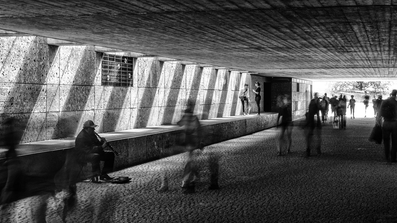 The Clarinettist Architecture Built Structure Day Fading Away Lifestyles Mammal Men Nikonphotography People Real People Standing Streetphotography Subway Station