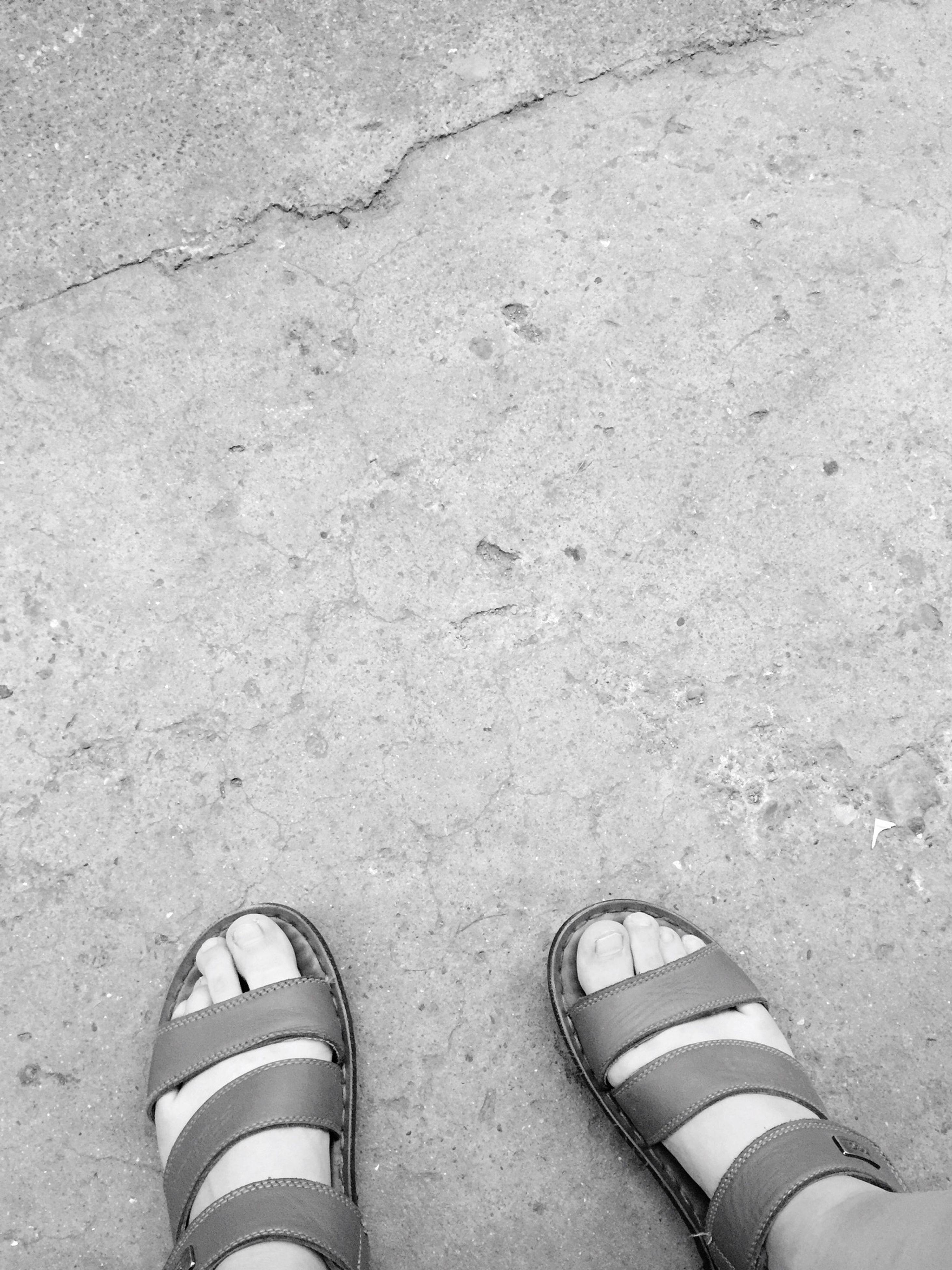 high angle view, shoe, low section, personal perspective, person, directly above, footwear, part of, sand, outdoors, day, textured, beach, human foot, one person, street, pattern, sunlight, concrete, ground