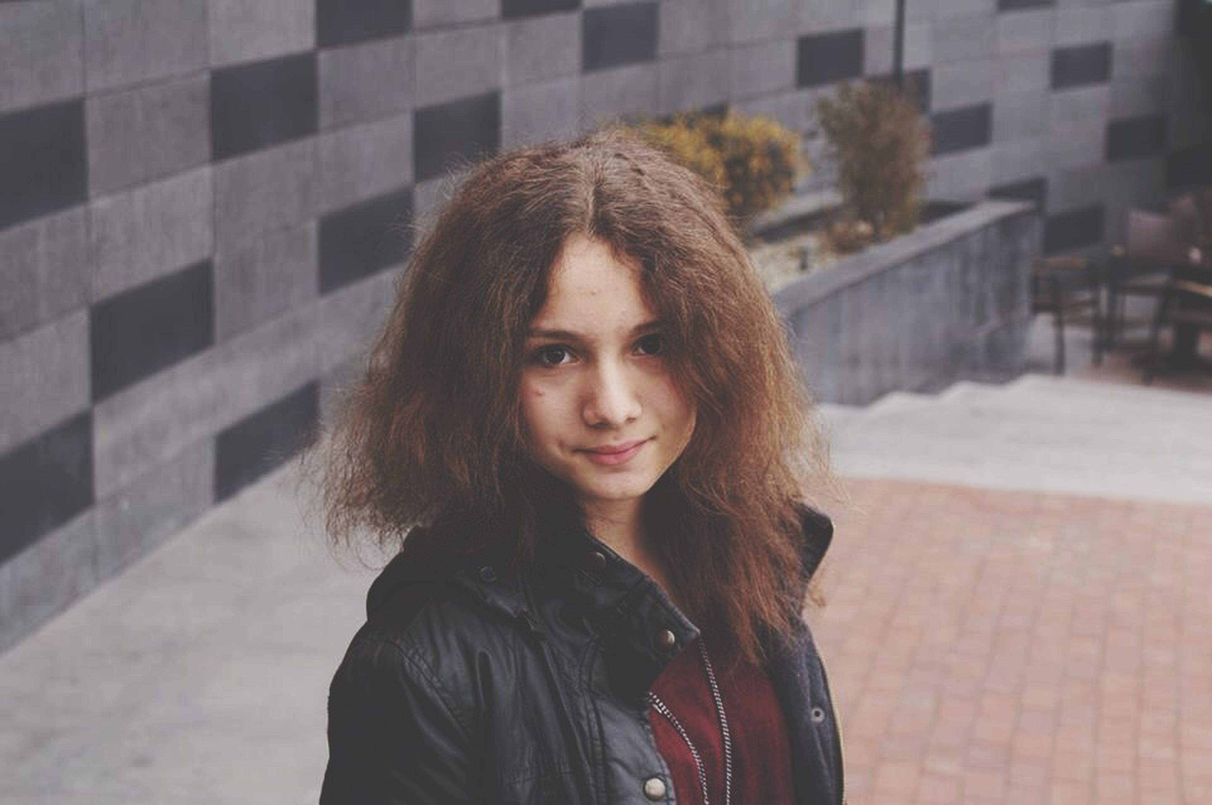 young adult, portrait, looking at camera, young women, person, lifestyles, long hair, front view, casual clothing, leisure activity, smiling, headshot, focus on foreground, standing, waist up, brown hair, black hair