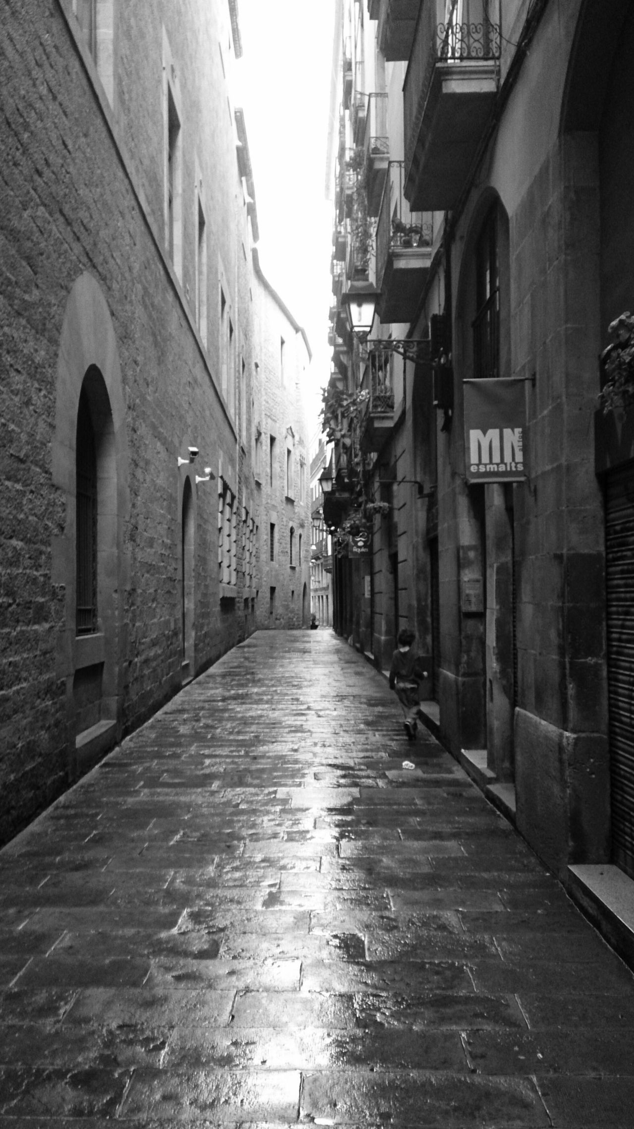Old Street at the Gothic Quarter , Barcelona . Mobilephotography Mobile Photography Sony Xperia Zr Old Kid Walking Alone Street Photography Street Streetphotography Tourist Destination Tourist Attraction  Gothic Architecture Architecture Narrow Street Architecture Photography Black And White Black And White Photography Perspective Showcase July