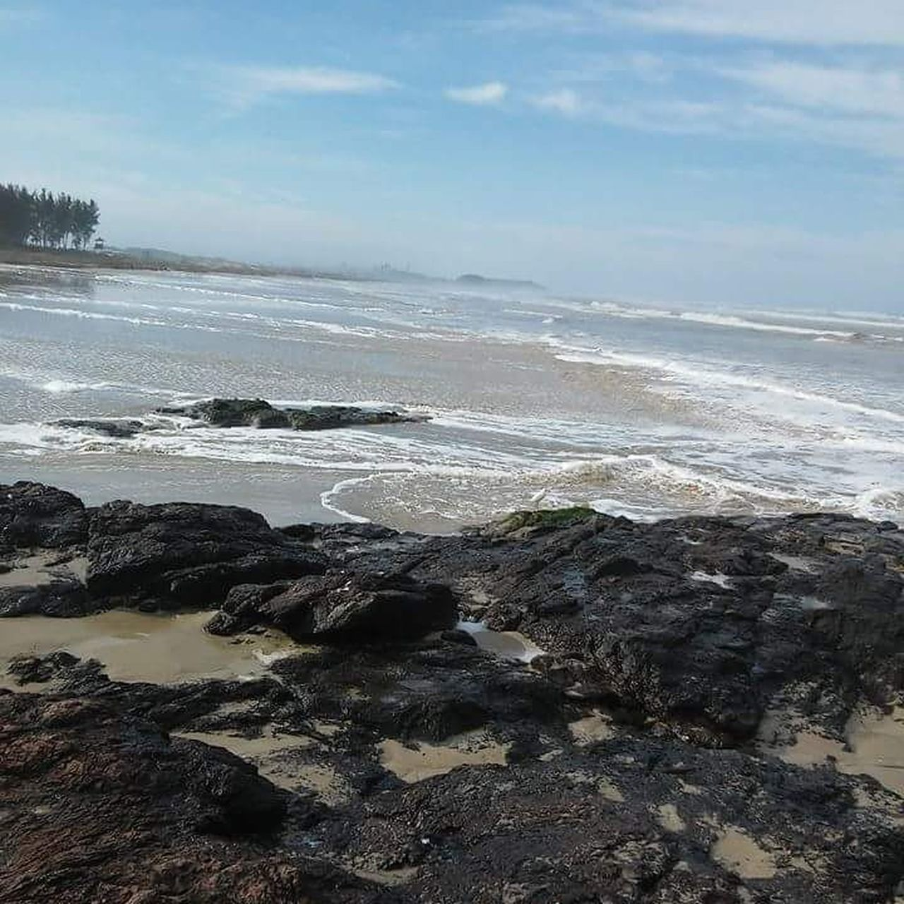 sea, nature, beauty in nature, water, beach, sky, scenics, tranquility, tranquil scene, no people, outdoors, rock - object, horizon over water, wave, day