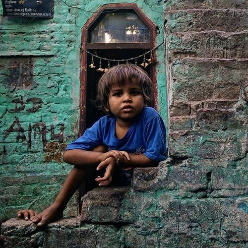 "An Indian boy poses for a photo at Katputli Nagar, New Delhi, India. (3/5) Many a times, I have been approached by kids urging me to take pictures of them. They shout, ""Ek photo! Ek photo!"" (One photo, one photo). The glee on their faces at the prospect of getting photographed makes me more than happy to oblige. After photographing the children, I realised that their expressions and their poses make the pictures special to me. Everydayeverywhere Dailylife Photojournalism Journalism Indiaphotoproject Reportagespotlight _soi Dfordelhi Sodelhi DelhiGram Delhi Newdelhi ASIA India"