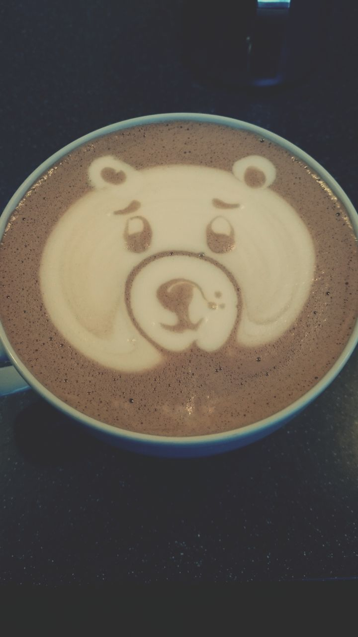 Teddy Bear Art On Cappuccino Served On Table