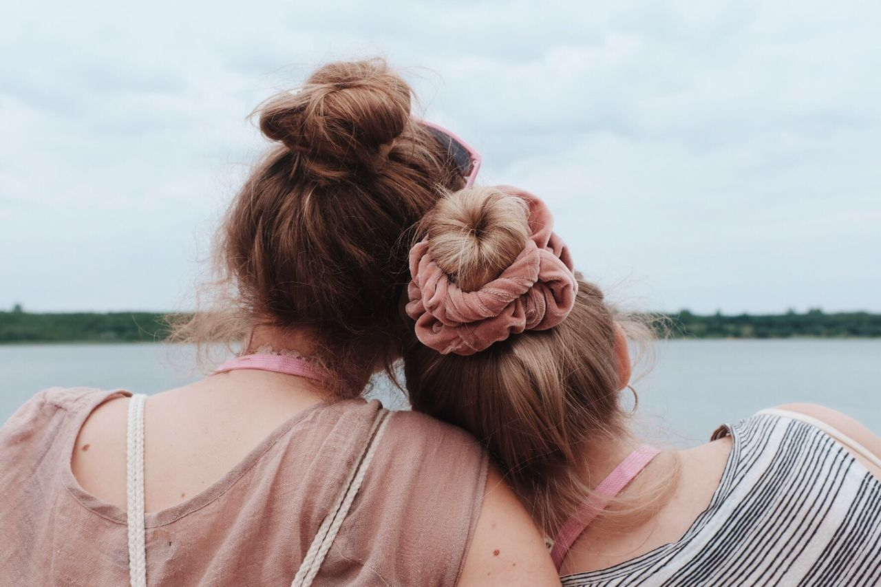 Rear View Sky Day Real People Water Outdoors Togetherness Long Hair Leisure Activity Cloud - Sky Casual Clothing Headshot Women Nature Sitting Bonding Young Women Young Adult Friendship Close-up Sisters