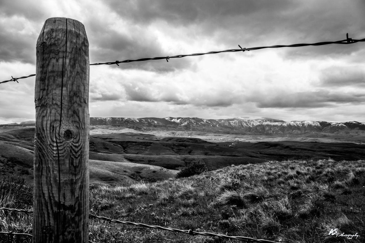 Home on the Range Sky Outdoors Barbed Wire No People Day Cloud - Sky Nature Tranquility Tranquil Scene Landscape Mountain Scenics Beauty In Nature Water Close-up