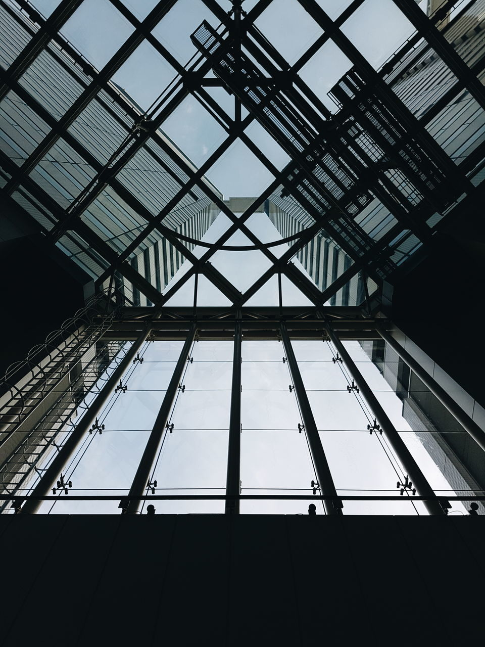 Low Angle View Of Building Through Glass Ceiling