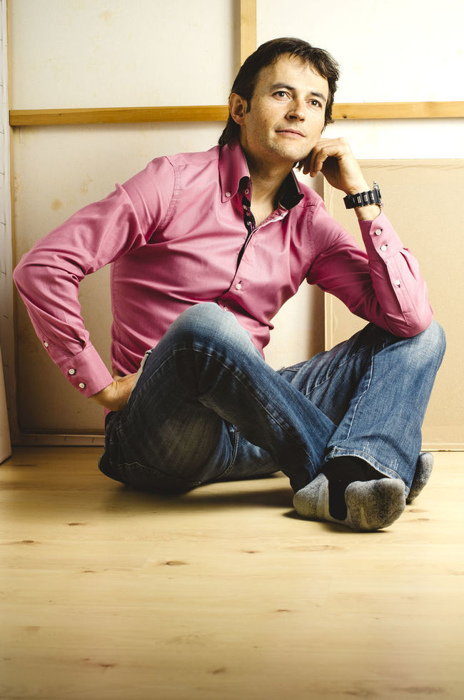 40 Years Old Artist Casual Clothing Casual Look Casual Wear Caucasian Guy Lifestyle Man Optimistic Pink Shirt Sitting On Floor Thinking About Her Thinking About Life