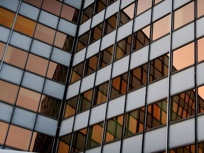 Reflection in the glassbuilding opposite the sun Abstract Antwerp, Belgium Architecture Architecture Architecture_collection Building Exterior Built Structure Conformity Docks Ewandraful Geometric Shape Glass Wall Glass Wall And Its Reflections Harbour View Mirror Mirrored Reflection Orange Sky Pattern Pattern Pieces Pattern, Texture, Shape And Form Reflection Reflection_collection Reflections Sunset Sunset Reflection